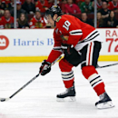 Chicago Blackhawks left wing Patrick Sharp (10) shoots the puck and scores against the Carolina Hurricanes during the second period of an NHL hockey game in Chicago, Friday, March 21, 2014 The Associated Press