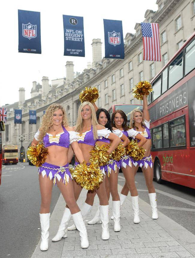 In this image made available by the NFL, Minnesota Vikings cheerleaders stand in London's Regent Street during an arranged photo shoot, Wednesday, Sept. 25, 2013. The Minnesota Vikings will play the Pittsburgh Steelers at London's Wembley Stadium on Sunday