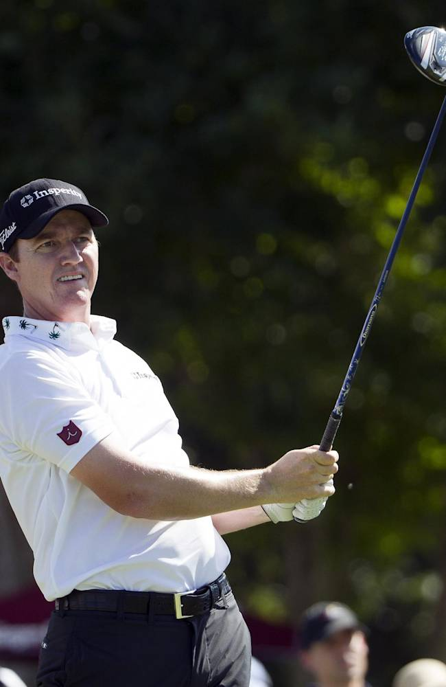 Jimmy Walker watches his drive off the first tee during the fourth round of the Sony Open golf tournament at Waialae Country Club, Sunday, Jan. 12, 2014, in Honolulu