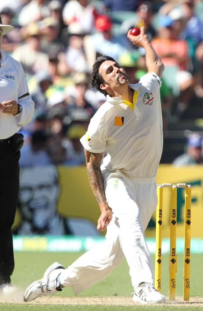 Australia's Mitchell Johnson bowls during the second Ashes cricket test match between England and Australia, Adelaide, Australia, Friday, Dec. 6, 2013