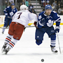 Toronto Maple Leafs Phil Kessel, right, takes the puck away from Columbus Blue Jackets Jack Johnson during the second period of an NHL hockey game in Toronto on Monday, March 3, 2014 The Associated Press