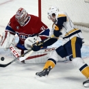 Nashville Predators' Craig Smith (15) is stopped by Montreal Canadiens goalie Carey Price (31) during the first period of an NHL hockey game Tuesday, Jan. 20, 2015, in Montreal The Associated Press