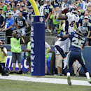 Denver Broncos wide receiver Demaryius Thomas (88) ties the game with a catch on a 2-point conversion as Seattle Seahawks cornerback Richard Sherman (25) defends in the second half of an NFL football game, Sunday, Sept. 21, 2014, in Seattle The Associated