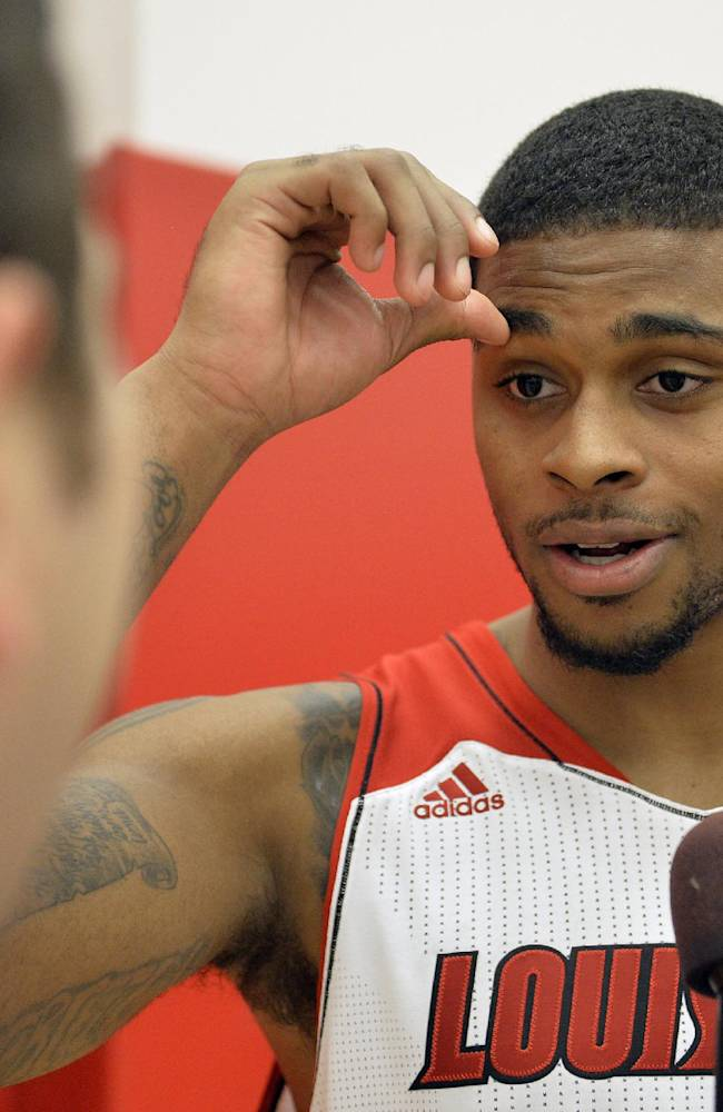 Louisville's Chane Behanan fields questions during NCAA college basketball media day, Saturday, Oct. 12, 2013, in Louisville, Ky