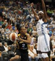 Tulsa Shock guard Temeka Johnson (2) looks to make a pass around Minnesota Lynx forward Taj McWilliams-Franklin (8) during the first half of a WNBA basketball game, Thursday, July 12, 2012, in Minneapolis. (AP Photo/Stacy Bengs)