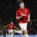 Manchester United's Phil Jones, right, celebrates after scoring the opening gaol during their Champions League group A soccer match between Manchester United and Shakhtar Donetsk at Old Trafford Stadium, Manchester, England, Tuesday, Dec. 10, 2013