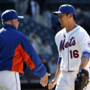 New York Mets manager Terry Collins, left, congratulates relief pitcher Daisuke Matsuzaka (16) after Matsuzaka closed out a 4-1 victory over the St. Louis Cardinals in a baseball game in New York, Thursday, April 24, 2014 The Associated Press