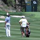 Davis Love III tosses blades of grass in the air to test the wind direction with his caddie before his second shot on the downhill 464-yard, par-4 17th hole Sunday Aug. 4, 2013 in the final round of the Reno-Tahoe Open at Montreux Golf Club. (AP Photo/Scott Sonner)
