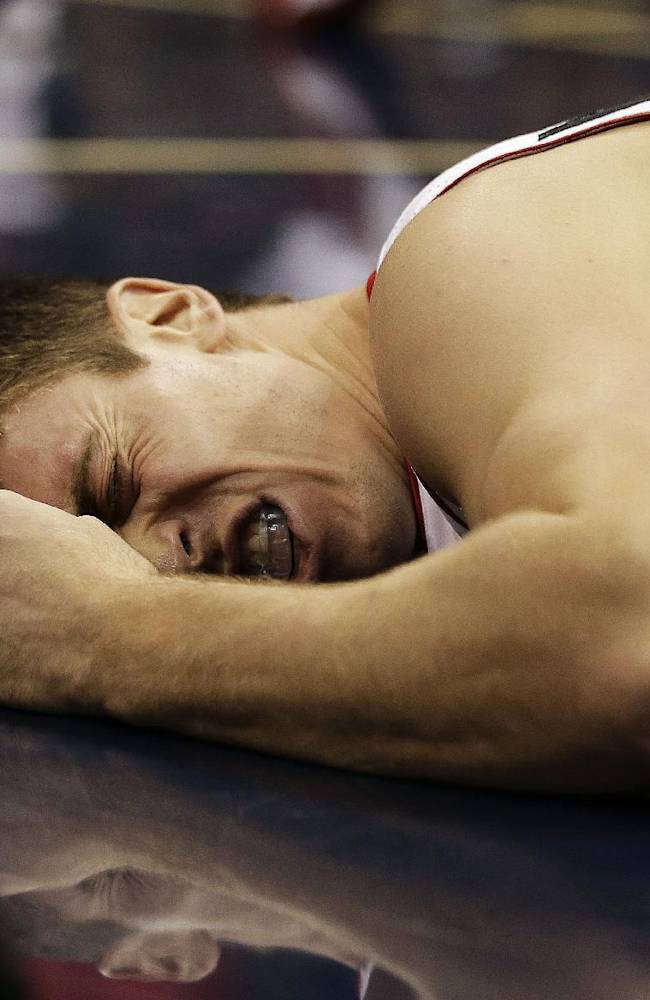 Toronto Raptors forward Tyler Hansbrough reacts after falling in the first half of an NBA basketball game against the Atlanta Hawks, Friday, Nov. 1, 2013, in Atlanta. Hansbrough was not injured on the play and remained in the game