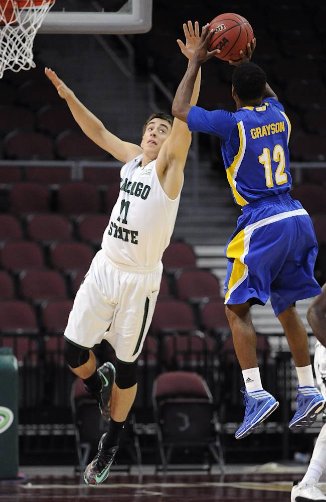 Bakersfield's Issiah Grayson (12) shoots against Chicago State's Jared Dimakos during the first half of an NCAA college basketball game in the first round of the West Athletic Conference men's tournament Thursday, March 13, 2014, in Las Vegas