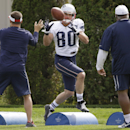 New England Patriots wide receiver Danny Amendola (80) works a running and catching drill as running backs coach Ivan Fears, right, looks on during a stretching session before practice begins at the NFL football team's facility Wednesday, Sept. 24, 2014 i