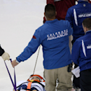 Toronto Maple Leafs center Daniel Winnik is removed from the ice after being injured in the first period of an NHL hockey game against the Coloado Avalanche in Denver, Thursday, Nov. 6, 2014 The Associated Press