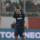 Manchester United's Robin van Persie applauds the fans of his team after a Champions League, round of 16, first leg soccer match against Olympiakos at Georgios Karaiskakis stadium, in Piraeus port, near Athens, on Tuesday, Feb. 25, 2014. Olympiakos won 2-