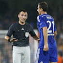 Referee Ivan Bebek, left, talks to Chelsea's Nemanja Matic during the Champions League group G soccer match between Chelsea and Schalke 04 at Stamford Bridge stadium in London, Wednesday, Sept. 17, 2014