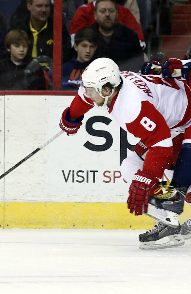 Detroit Red Wings left wing Justin Abdelkader, left, and Washington Capitals right wing Alex Ovechkin. right, from Russia, collide in the first period of an NHL hockey game on Sunday, Feb. 2, 2014, in Washington