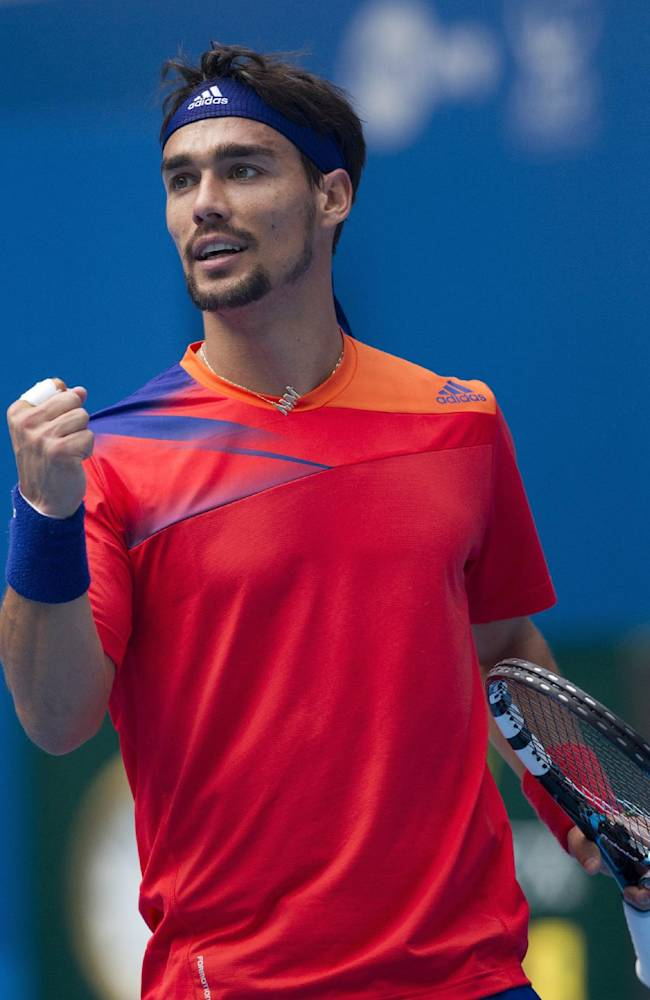 Fabio Fognini of Italy reacts to getting a point in his match against Rafael Nadal of Spain during the quarterfinal match of the China Open tennis tournament at the National Tennis Stadium in Beijing, China Friday, Oct. 4, 2013