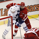 Toronto Maple Leafs' Joffrey Lupul is defended by Detroit Red Wings' Tomas Tatar (21), of Slovakia, as Detroit Red Wings goalie Jonas Gustavsson (50), of Sweden, covers the puck during overtime of an NHL hockey games Saturday, Oct. 18, 2012, in Detroit Th