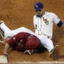 LSU's Tyler Moore, top, gets tangled with Arkansas base runner Matt Vinson on a pick off attempt in the eighth inning of their Southeastern Conference Tournament NCAA college baseball game at the Hoover Met in Hoover, Ala., Thursday, May 23, 2013. (AP Photo/Dave Martin)