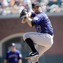 Colorado Rockies starting pitcher Tyler Chatwood throws to the San Francisco Giants during the first inning of the MLB National League baseball game on Sunday, April 13, 2014, in San Francisco The Associated Press