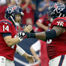 Houston Texans quarterback Ryan Fitzpatrick, left, is congratulated by teammate Duane Brown, right, after throwing a 7-yard touchdown pass to DeAndre Hopkins during the fourth quarter of an NFL football game against the Philadelphia Eagles, Sunday, Nov. 2