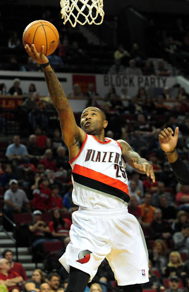Portland Trail Blazers guard Mo Williams (25) drives to the basket during the first half of an NBA basketball game against the Sacramento Kings on Sunday, Oct. 20, 2013, in Milwaukee