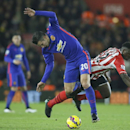Manchester United's Robin Van Persie, left, tussles for the ball with Southampton's Victor Wanyama during their English Premier League soccer match between Southampton and Manchester United at St Mary's stadium in Southampton, England, Monday, Dec. 8, 201