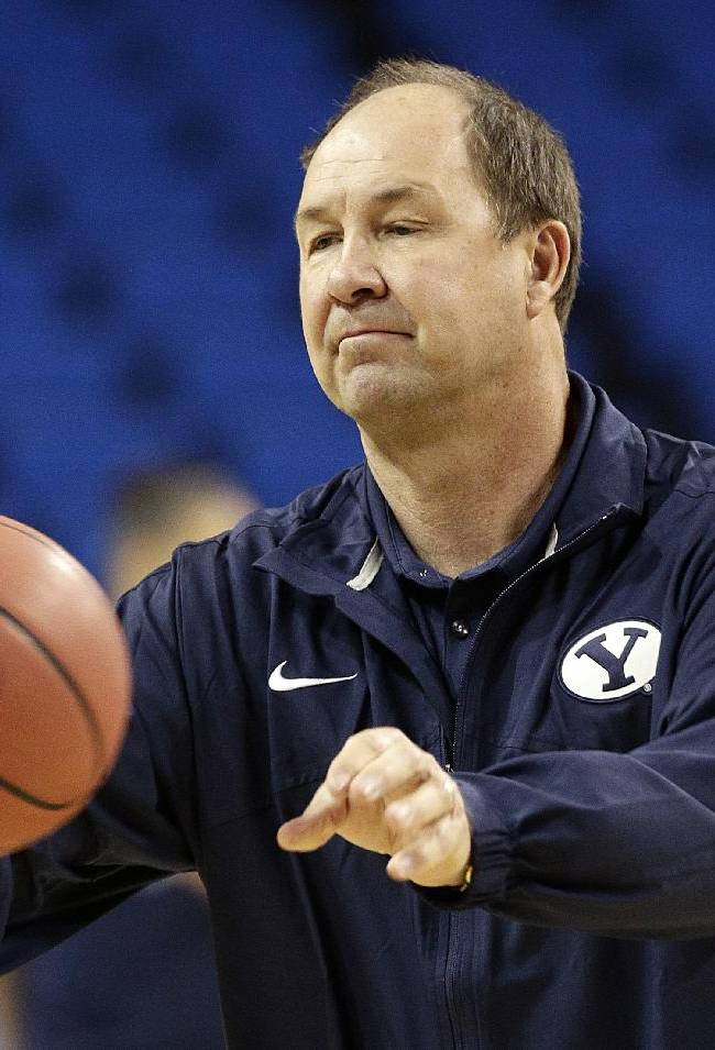 Brigham Young University head coach Jeff Judkins passes the ball during practice for the NCAA women's college basketball tournament on Friday, March 21, 2014, in Los Angeles. BYU is scheduled to play North Carolina State in a first-round game on Saturday