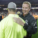 Dallas Cowboys head coach Jason Garrett chats with Baltimore Ravens head coach John Harbaugh after Team Irvin defeated Team Carter 32-28 in the NFL Football Pro Bowl Sunday, Jan. 25, 2015, in Glendale, Ariz The Associated Press