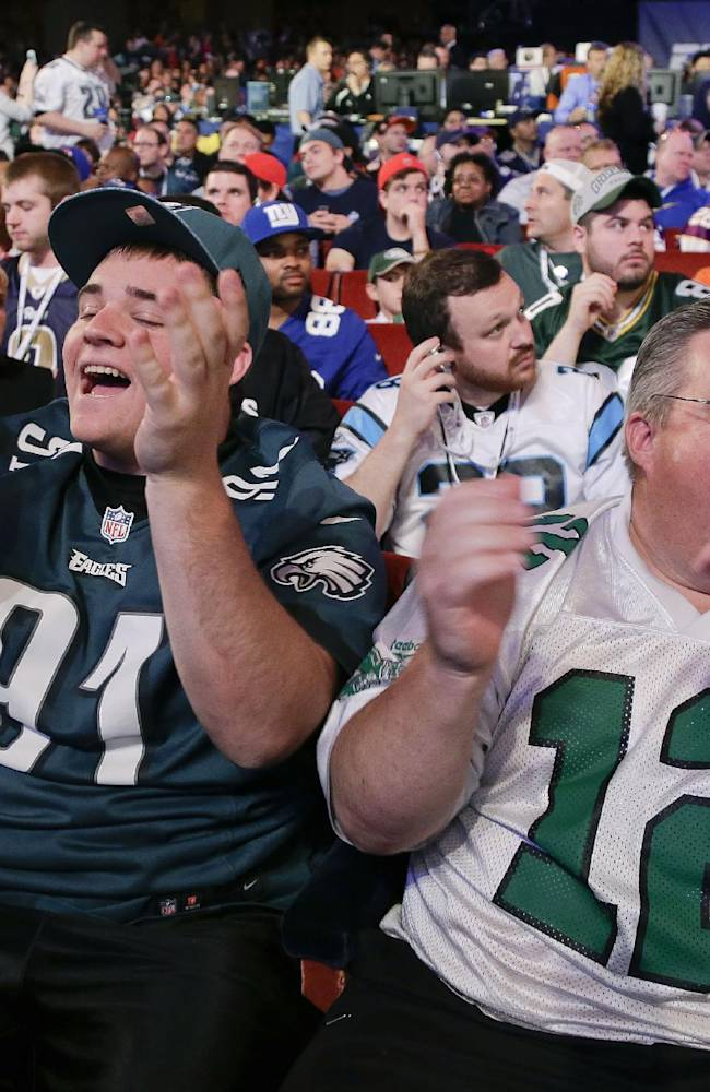 John Peniston, right, and his son, Sean, of Jamison, Pa., react to the announcement of the Philadelphia Eagles fourth-round selection at the 2014 NFL Draft, Saturday, May 10, 2014, in New York. The Eagles chose Florida cornerback Jaylen Watkins