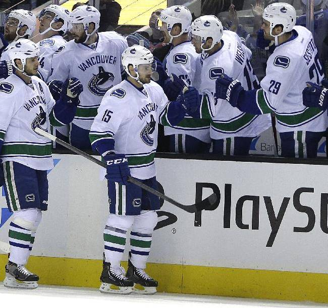 Vancouver Canucks' Brad Richardson (15) is congratulated after scoring against the San Jose Sharks during the first period of an NHL hockey game on Thursday, Nov. 7, 2013, in San Jose, Calif