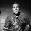 In this undated file photo, New York Rangers hockey player Tim Horton poses for a photo in New York. Few things unite Canadians the way Tim Hortons does. For half a century, they have warmed themselves on chilly mornings with the chain's coffee and Timbit