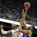 Duke's Jabari Parker, right, has his shot blocked by Virginia's Akil Mitchell, left, during the first half of an NCAA college basketball game in the championship of the Atlantic Coast Conference tournament in Greensboro, N.C., Sunday, March 16, 2014. (AP Photo/Bob Leverone)