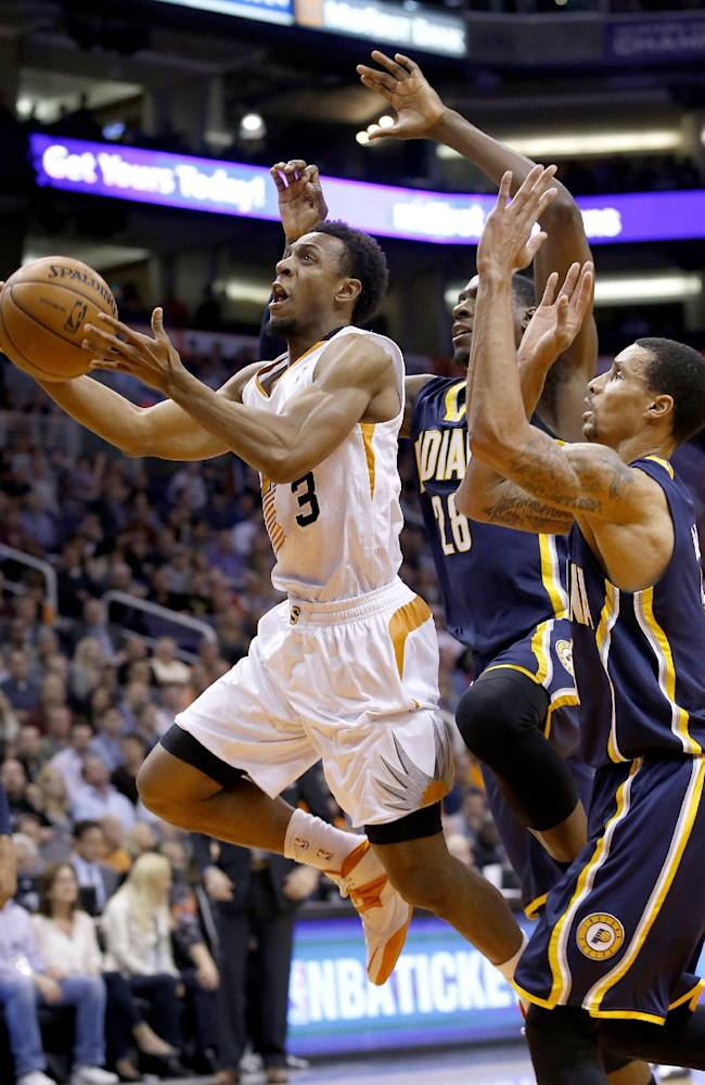 Phoenix Suns' Ish Smith (3) beats Indiana Pacers' George Hill, right, and Ian Mahinmi (28), of France, for a score during the second half of an NBA basketball game Wednesday, Jan. 22, 2014, in Phoenix.  The Suns defeated the Pacers 124-100