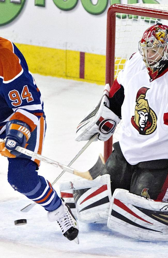 Ottawa Senators goalie Craig Anderson (41) makes the save as Edmonton Oilers' Ryan Smyth (94) looks for the rebound during third period NHL hockey action in Edmonton,  Alberta, on Tuesday March 4, 2014