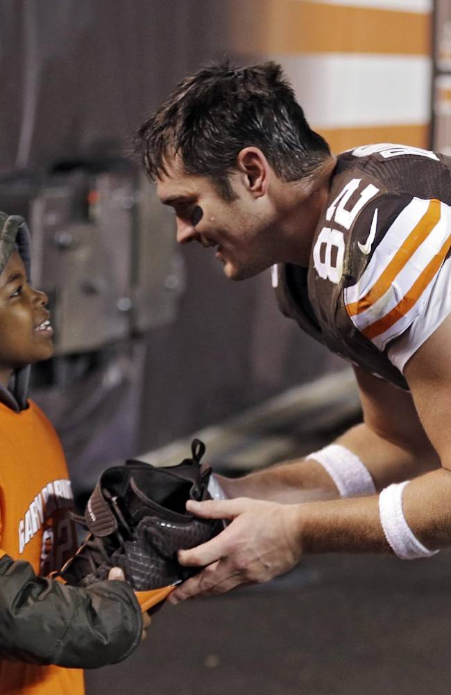 Cleveland Browns tight end Gary Barnidge (82) hands his shoes to Devon Aire after the Browns' 24-18 win over the Baltimore Ravens in an NFL football game Sunday, Nov. 3, 2013, in Cleveland. Barnidge caught a 4-yard touchdown pass in the game
