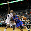 Detroit Pistons guard Rodney Stuckey (3) drives to the basket against Atlanta Hawks guard Shelvin Mack (8) during the second period of an NBA basketball game in Atlanta, Tuesday, April 8, 2014. The Pistons won the game 102-95 The Associated Press