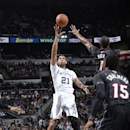 SAN ANTONIO, TX - March 6: Tim Duncan #21 of the San Antonio Spurs takes a shot during a game against the Miami Heat at the AT&T Center on March 6, 2014 in San Antonio, Texas