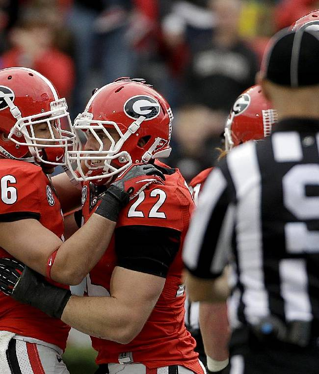 Georgia running back Brendan Douglas (22) celebrates with teammate Michael Erdman after scoring a touchdown in the second half of an NCAA college football game against Appalachian State, Saturday, Nov. 9, 2013, in Athens, Ga