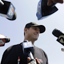 In this May 23, 2014, file photo, San Francisco 49ers coach Jim Harbaugh speaks to reporters during an NFL football rookie camp in Santa Clara, Calif. Harbaugh is in the fourth year of his $25 million, five-year contract coaching the 49ers, and the relati