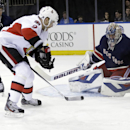 New York Rangers goalie Henrik Lundqvist (30), of Sweden, stops a shot by Ottawa Senators' Milan Michalek (9) during the first period of an NHL hockey game Saturday, April 5, 2014, in New York The Associated Press