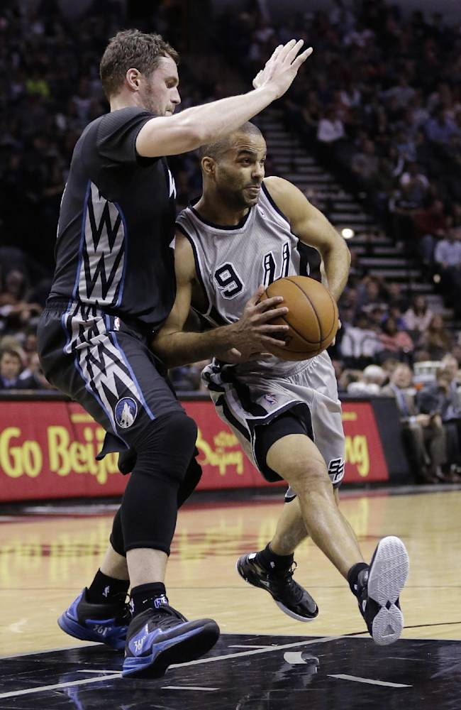 San Antonio Spurs' Tony Parker (9), of France, drives around Minnesota Timberwolves' Kevin Love, left, during the first half on an NBA basketball game, Sunday, Jan. 12, 2014, in San Antonio. San Antonio won 104-86