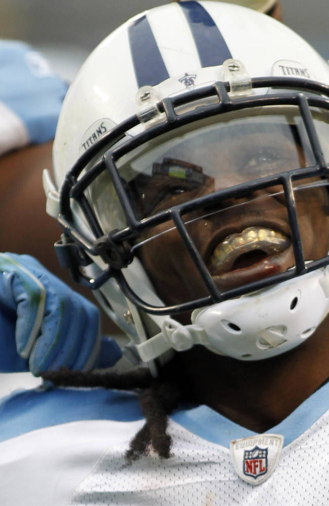 In a Nov. 13, 2011 file photoTennessee Titans' Chris Johnson celebrates his touchdown run against the Carolina Panthers during an NFL football game in Charlotte, N.C.  Jones  told the gathering at the NFL's annual rookie symposium how he dropped $1 million in Las Vegas  over the course of a single weekend
