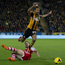 Hull City's Ahmed Elmohamady, top, is brought down for a free kick by Southampton's Luke Shaw during their English Premier League soccer match at the KC Stadium, Hull, England, Tuesday Feb. 11, 2014