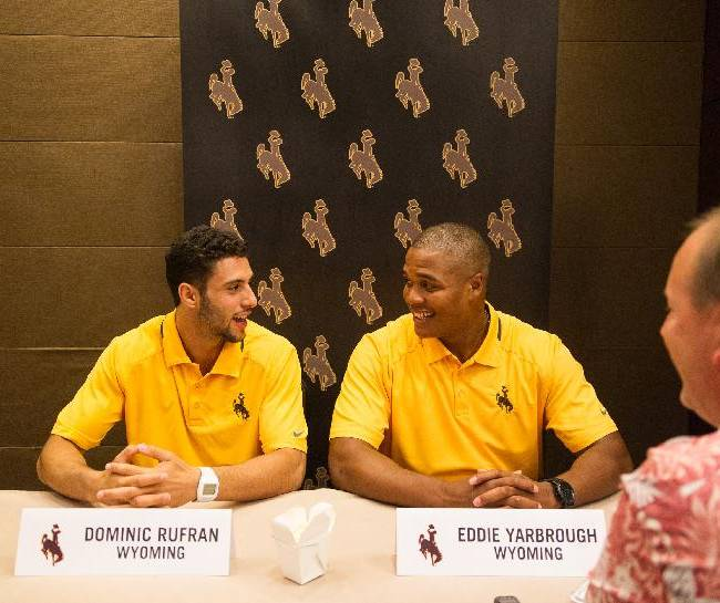 Wyoming's Dominic Rufran, left, and Eddie Yarbrough speak with the media at the Mountain West Conference  NCAA college football media day Tuesday, July 22, 2014, in Las Vegas