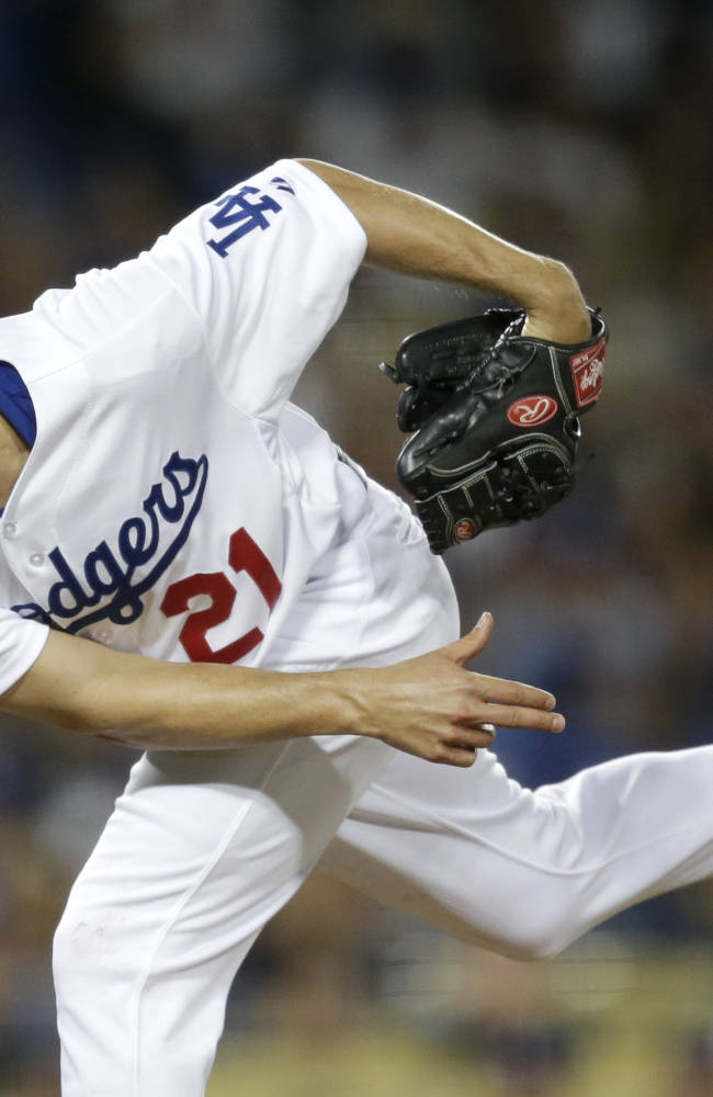 Los Angeles Dodgers starting pitcher Zack Greinke throws against the San Francisco Giants during the sixth inning of a baseball game on Thursday, Sept. 12, 2013, in Los Angeles