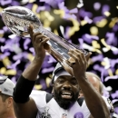 Baltimore Ravens safety Ed Reed celebrates with the Vince Lombardi Trophy after their 34-31 win against the San Francisco 49ers in the NFL Super Bowl XLVII football game Sunday, Feb. 3, 2013, in New Orleans. (AP Photo/Julio Cortez)
