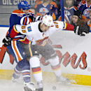 Calgary Flames' Shane O'Brien (55) battles for the puck with Edmonton Oilers' Ryan Smyth (94) during second period NHL hockey action in Edmonton, Alberta., on Saturday Dec. 7, 2013 The Associated Press