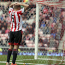 Sunderland's Wes Brown puts his hands on his head after scoring an own goal during the English Premier League soccer match against Everton at the Stadium of Light, Sunderland, England, Saturday, April 12, 2014