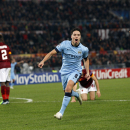 Manchester City's Samir Nasri celebrates after scoring during a Group E Champions League soccer match between Roma and Manchester City at the Olympic stadium in Rome, Italy, Wednesday Dec.10, 2014