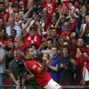 Manchester United's Robin Van Persie celebrates his goal against Wigan Athletic during their English FA Community Shield soccer match at Wembley Stadium in London, Sunday, Aug. 11, 2013. (AP Photo/Jon Super)